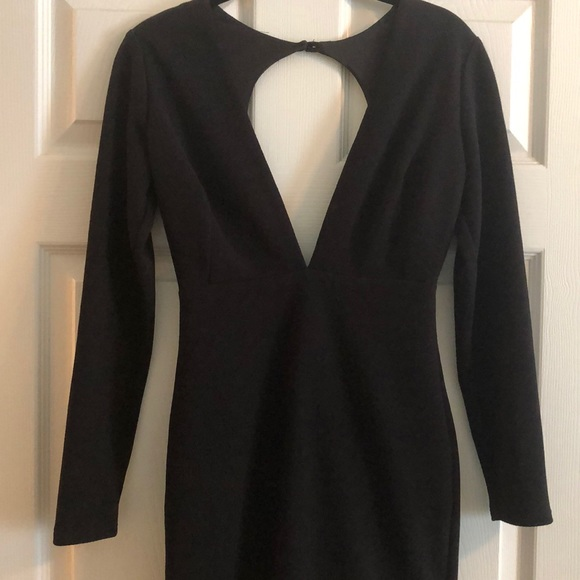 Rubber Ducky Productions, Inc. Dresses & Skirts - Black long sleeve bodycon dress